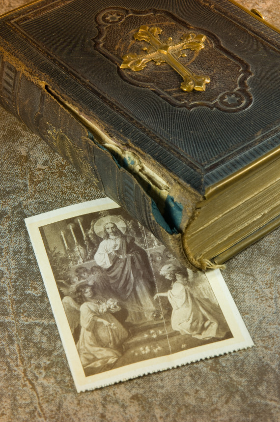 Old bible with picture of saints