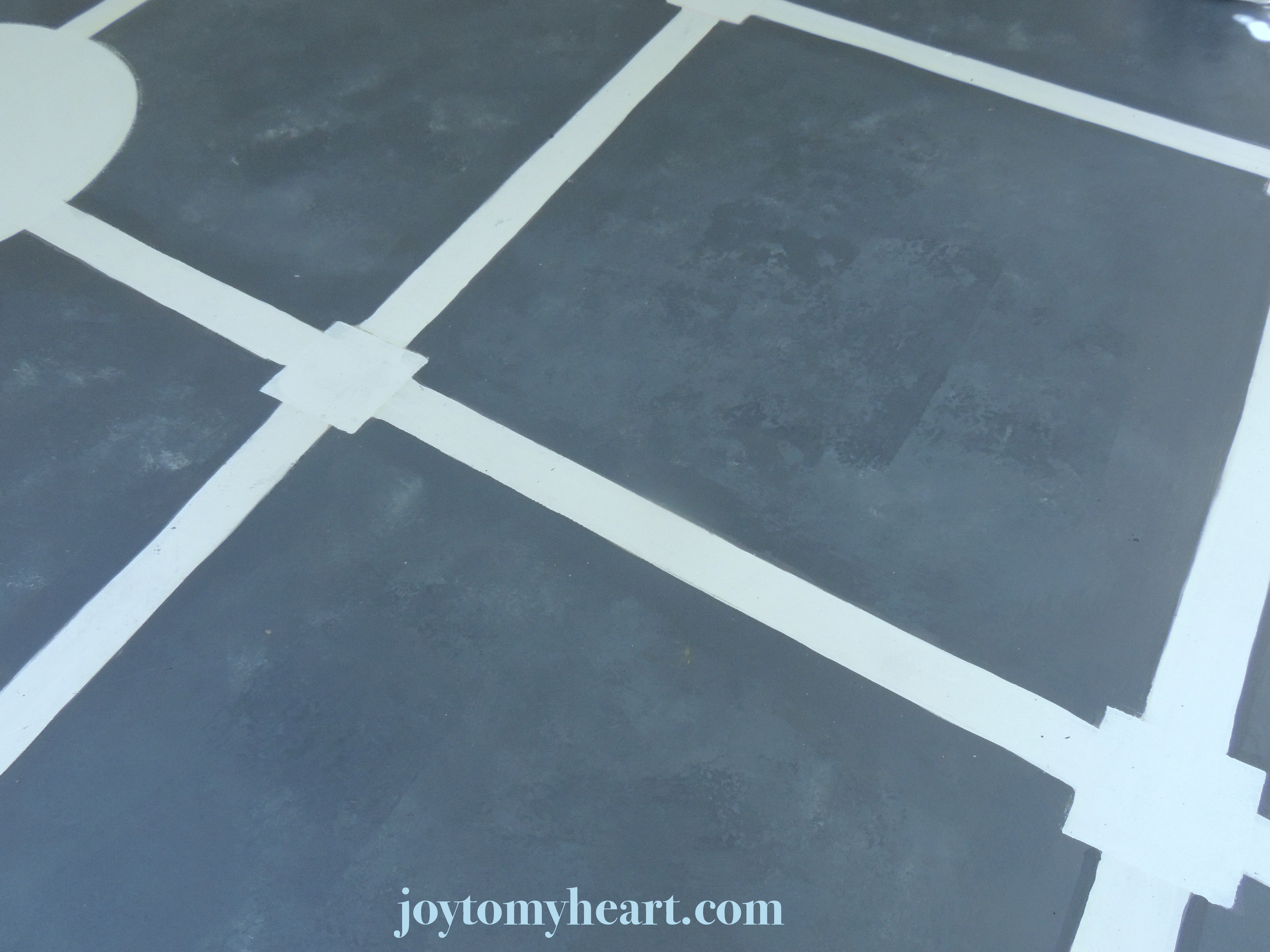 Diy paint a porch faux slate with stencil tiles joy to my heart after glazing a couple layers of paint and allowing to dry i used straight paint on the roller to leave pock marks very quickly roll lightly over a small dailygadgetfo Images